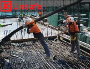 workers stretching hose for additional reach. This is unsafe work practice.