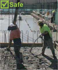 line hand and worker operating concrete vibrator