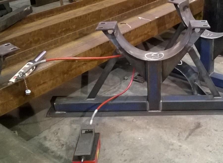 Photo 1. Shows portable power jack laying next fabricated metal bracket