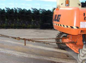 Photograph 3: EWP being driven up tilt tray with winch cable attached and operated simultaneously