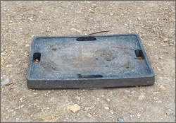 Photograph 1 – Outrigger pad on fill with no visual signs that the ground is soft