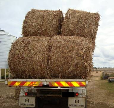 Bales transported on their sides or inadequately secured can move while being transported