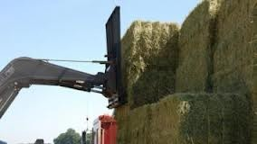 Front end loader with large square bale