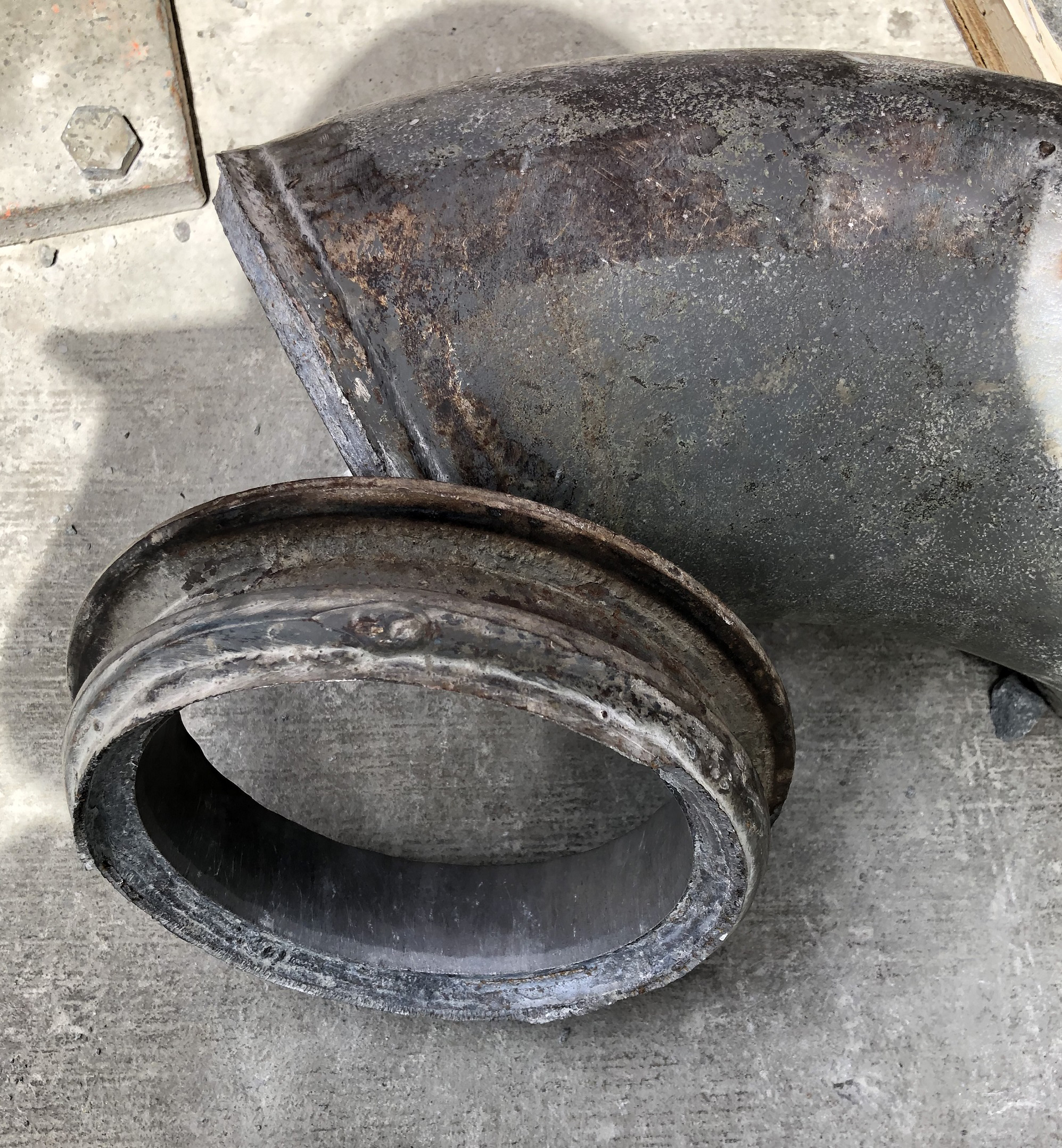 Photograph 3 - Failed flange on steel reducer bend.