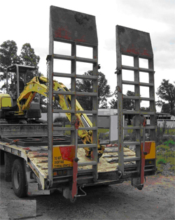 Photograph 1: Trailer ramps with single acting hydraulic cylinders