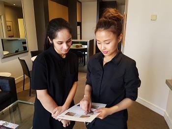 Housekeeping team using laminated training card.