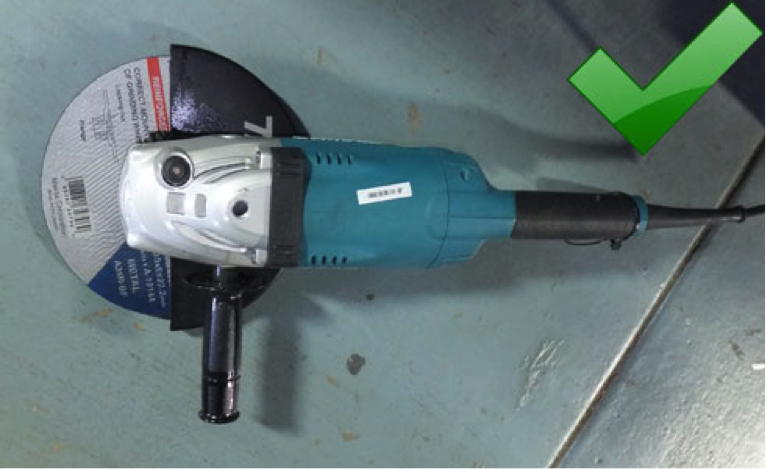 9-inch (230 mm) angle grinder with guard and right sized disc fitted.